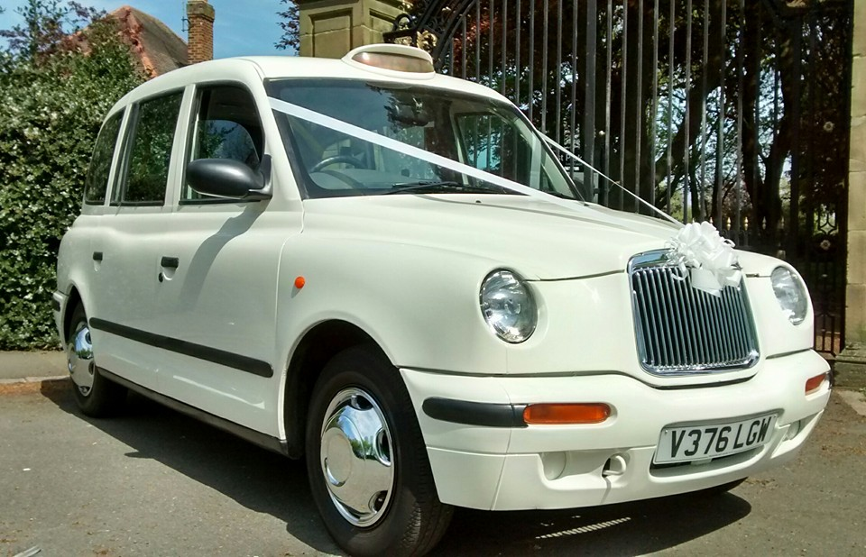 Primary image of White Taxi Wedding Car in [IQ_replace urlsegment=1]