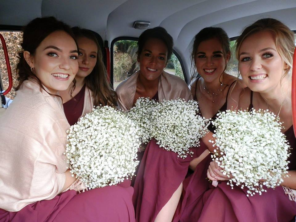 Interior full of bridesmaids in the White Taxi Wedding Car in Mansfield